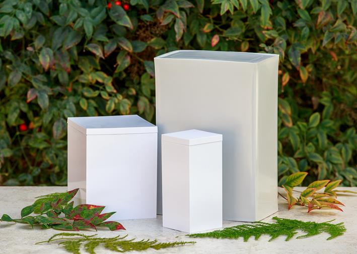 three white rectangular plastic urns